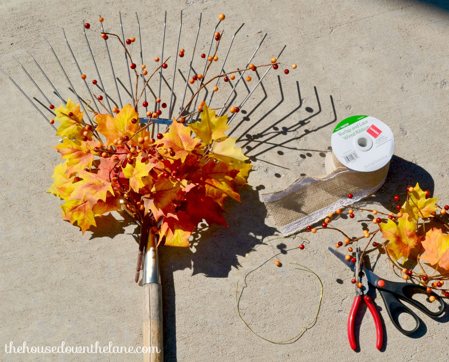 I've been wanting to add a rake to my fall decor for a long time, and I finally found one! Here's how I fall-ified it and created a DIY Welcoming Fall Rake! | From The House Down the Lane