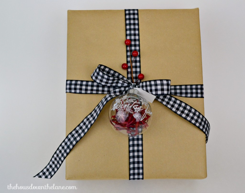 What do you get when you combine glass ball ornaments, rub-ons, and a few special details? Gift Tags That Will Make Your Packages Sparkle! | The House Down the Lane